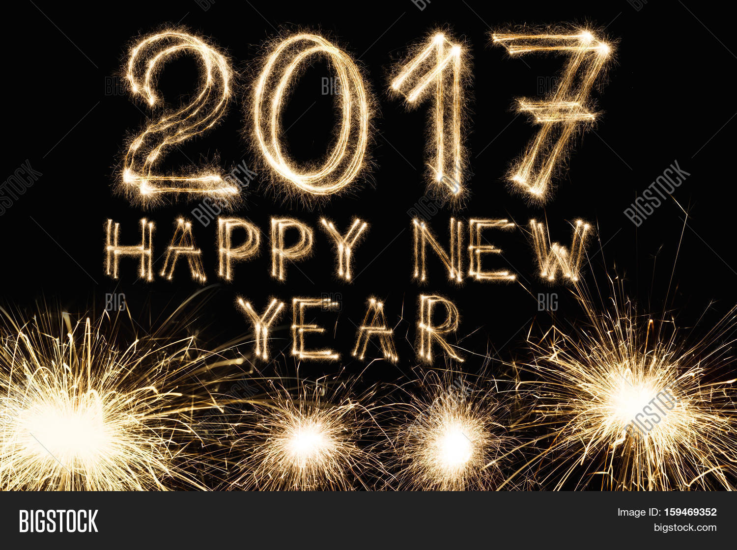 2017 new year font made from sparkler firework on black background with greeting letters two