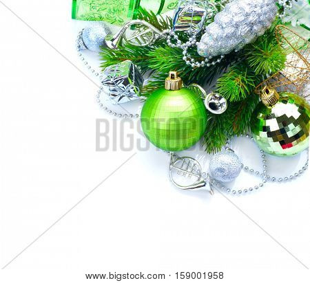 Christmas and New Year Green color Decoration isolated on white background. Border art design with holiday baubles. Beautiful Christmas tree closeup decorated with ball, cones, tinsel. Copy space