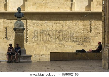 AIX EN PROVENCE,FRANCE-AUGUST 9,2016:people and tourist stroll and admire the Aix cathedral of Saint Sauveur during a sunny day.