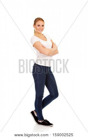 Happy young woman wiyh folded arms.