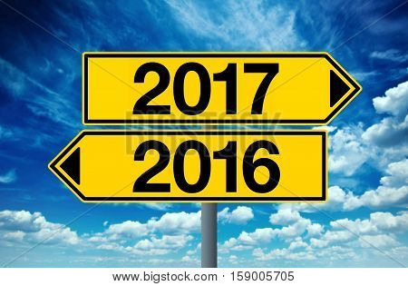 2016 and 2017 crossroad sign happy new year