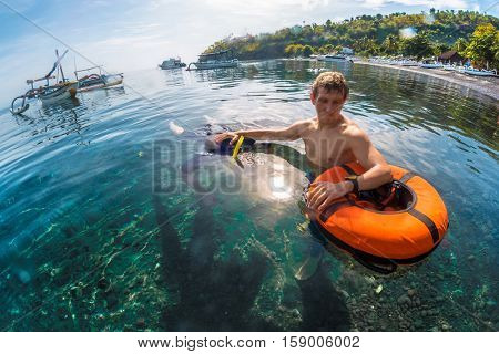 Free divers training static breath hold in a calm lagoon