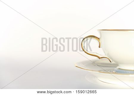beautiful porcelain tea cup and saucer on white background with copy space