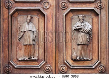 Wooden Portal of the Abbey of Holy Trinity in Florence, Italy