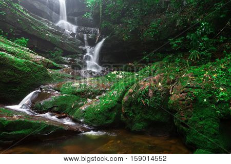 Saithip waterfall in Phu Soi Dao National Park Thailand. A small waterfal with beautiful scenery of lush rocks and forest line