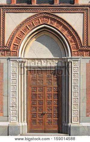 Entrance door of the romanic style church of Santa Maria in Strada. Monza, Italy