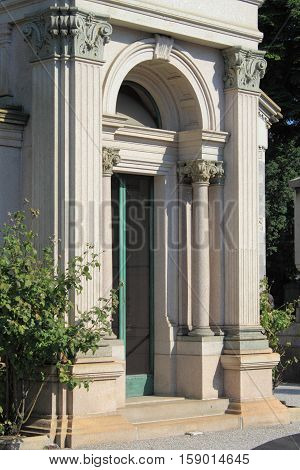 Entrance of a renaissance building with columns and corinthian decorations