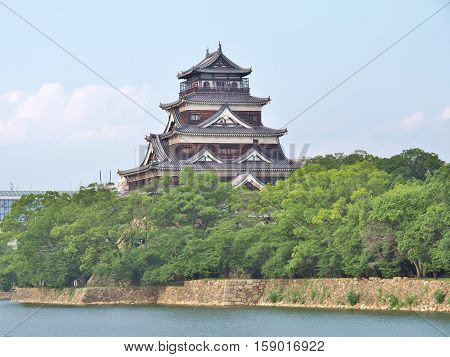 Hiroshima Castle on the side of Otagawa river in summer. The castle was destroyed by the atomic bombing on August 6, 1945 but was rebuilt in 1958.
