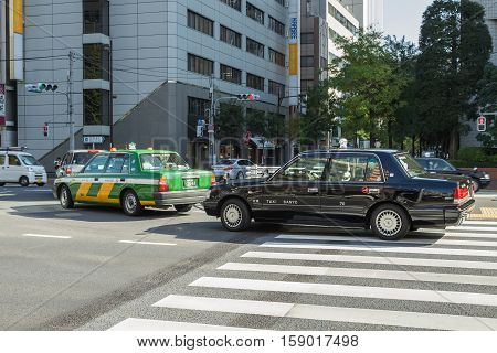 Tokyo, Japan - 18 NOV 2016 : Taxi car waiting for turn right at junction near Tsukiji market on 18 November 2016