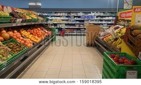 PRAGUE CZECH REPUBLIC - NOVEMBER 30 2016: Interior of grocery store Penny Market in Prague. Vegetable and dairy shelves and racks.