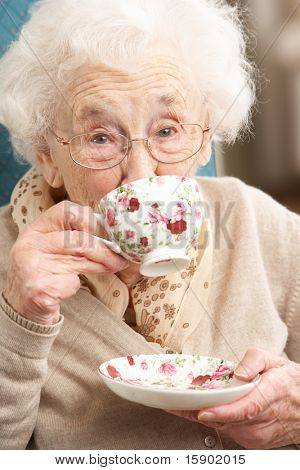 Senior Woman Enjoying Cup Of Tea At Home