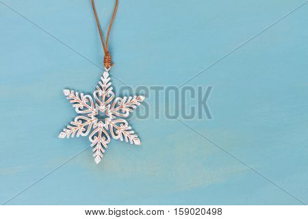 Christmas star on blue wooden background with copy space