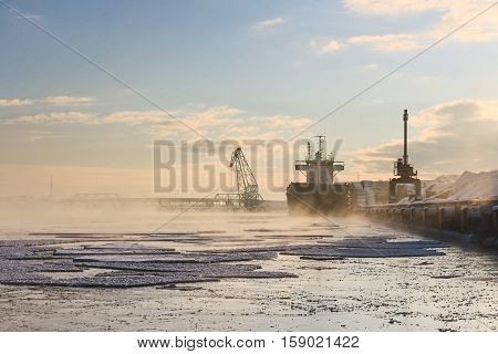 Bulker ship on the river in the winter in the port
