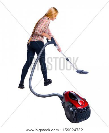 Rear view of woman with a vacuum cleaner. She is busy cleaning. Rear view people collection.  Isolated over white background. vacuum cleaner in the foreground and a woman in the background.