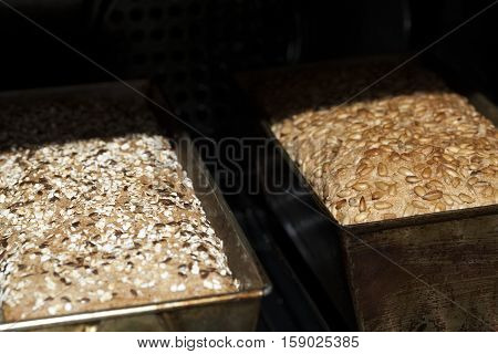 two hot bread in bread stove as background