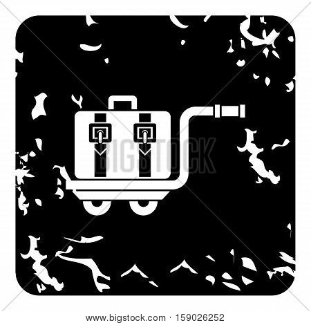 Suitcase on a cart icon. Grunge illustration of suitcase on a cart vector icon for web