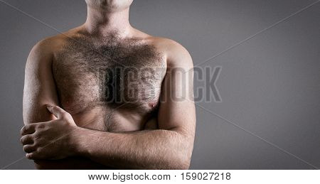 Man with hairy chest isolated on black background.
