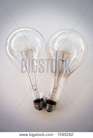 Two very large light bulbs with giant