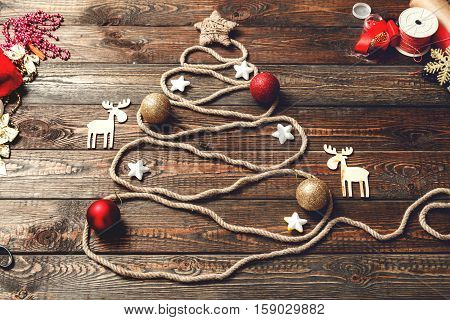 Christmas tree made of rope on a wooden background