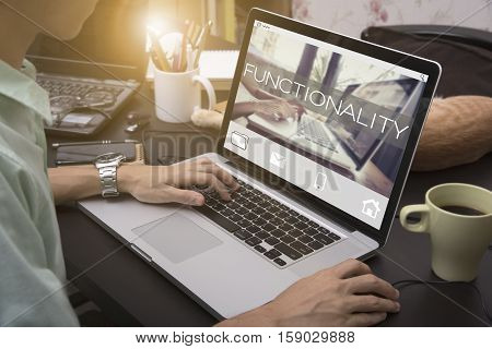 business hand typing on a laptop keyboard with Functionality homepage on the computer screen practical purpose suitable technology concept.