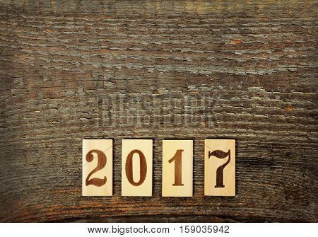 Numbers 2017 on old brown wooden background