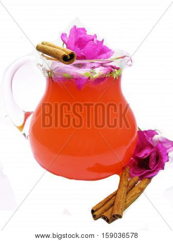 rose punch tea cocktail punch in jug with cinnamon sticks