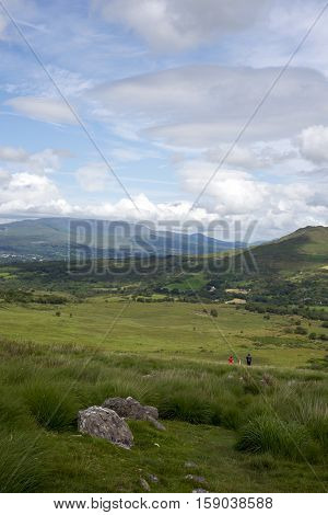 mountain view with hikers from the kerry way walk in ireland