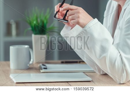 Female doctor reading patient medical history record in hospital office healthcare and medicine professional at work