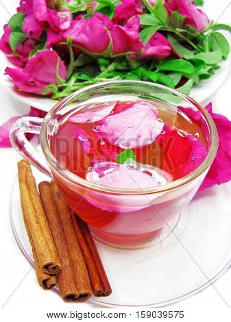 rose punch tea cocktail punch in jug and cup with cinnamon