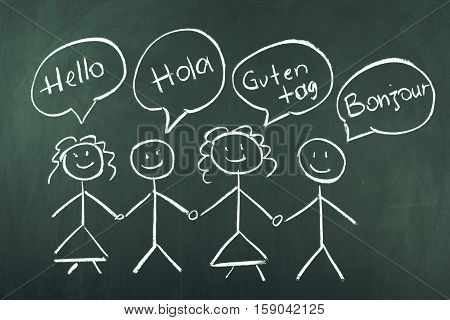 Hello in different languages concept on blackboard