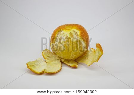ripe tangerine peeled, on a white background