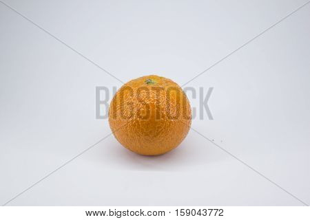 ripe juicy tangerine on a white background
