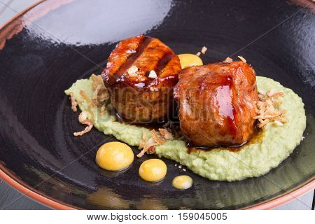 Prepared fillet mignon served with mashed potatoes
