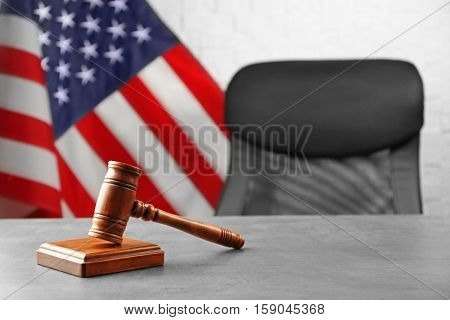 Judge gavel and soundboard on table