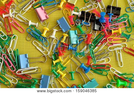 A collection of paper clips binder clips and push pins