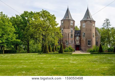 Entrance and towers of the historic Dussen castle in the municipality of Werkendam and in the Dutch province Noord-Brabant. The castle is originally built in 1393 and subsequently destroyed rebuilt and restored.