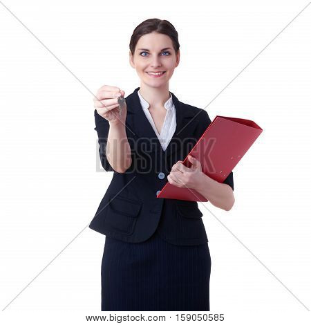 Smiling businesswoman standing over white isolated background with red folder and key in hands, business, education, office, sale, real estate concept
