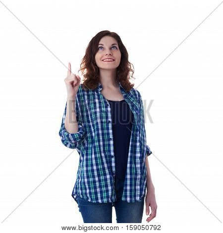 Smiling young woman in casual clothes over white isolated background pointing up, happy people concept