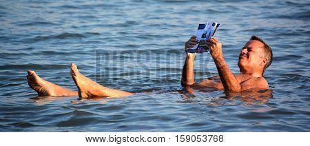 Dead man floating in water