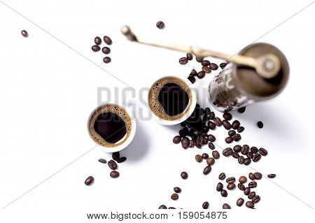 Two coffee cups coffee seeds and coffee mill