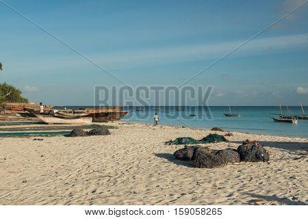 ZANZIBAR, TANZANIYA- JULY 13: seashore of fishing village with boats and nets on July 13, 2016 in Zanzibar