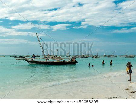 ZANZIBAR, TANZANIYA- JULY 09: beautiful sunset seascape with fishing boats near african coast on July 09, 2016 in Zanzibar