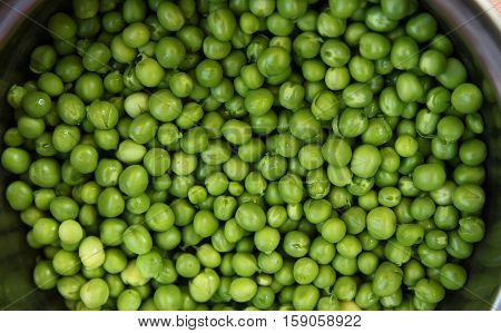 a green one  background of green peas