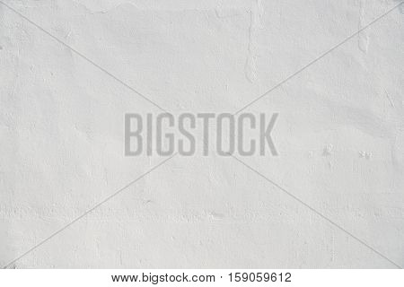 Abstract background. White wall of the house close up.