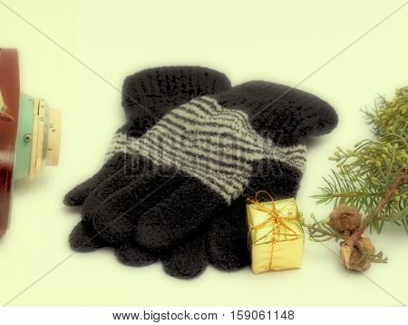 picture of a warm winter woolen gloves and gift box.polaroid effect