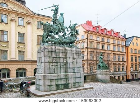 STOCKHOLM, SWEDEN - APRIL 11, 2010: Saint Göran (Saint George) and the Dragon Statue - bronze replica of Bernt Notke Sculpture. Located on Kopmantorget Square in Gamla Stan (Old Town).
