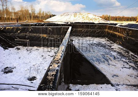 Construction of a new landfill for the storage of garbage and waste. Winter time