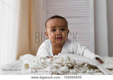 Portrait of a mixed race baby boy.