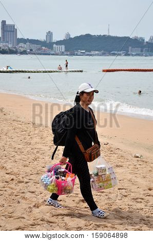 Local Merchant Selling Souvenirs To Tourists At Pattaya Beach
