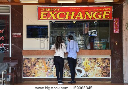 Money Exchange Shop On The Corner Of A Street In Pattaya